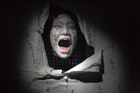 "A ghost figure is pictured at a haunted house in Tokyo Dome City amusement park in Tokyo September 2, 2010. Other nations drink water or eat watermelons in summer, but the Japanese flock to ""obake yashiki"" or ""haunted houses"" to shiver, tremble and in this way cool down as the worst heatwave in history strikes the country. REUTERS/Antoni Slodkowski"